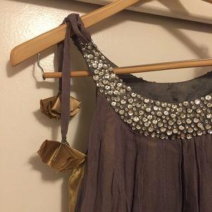 Metallic dress draped in flowers.